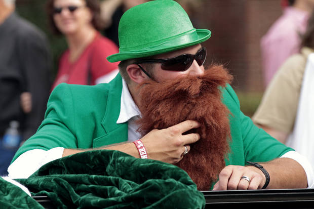 Michael Barber, dressed as St. Patrick, leans on the Engineering float before the homecoming parade prior to the University of Oklahoma Sooners (OU) play the Texas Tech University Red Raiders (TTU) on Saturday, Oct. 22, 2011. in Norman, Okla. Photo by Steve Sisney, The Oklahoman