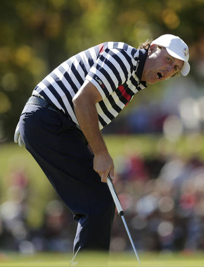 USA's Phil Mickelson reacts after missing a putt on the 13th hole during a singles match at the Ryder Cup PGA golf tournament Sunday, Sept. 30, 2012, at the Medinah Country Club in Medinah, Ill. (AP Photo/Charlie Riedel)  ORG XMIT: PGA152