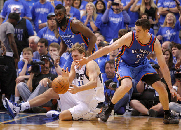 Oklahoma City's James Harden (13) and Nick Collison (4) defend Dallas' Dirk Nowitzki (41) during Game 4 of the first round in the NBA playoffs between the Oklahoma City Thunder and the Dallas Mavericks at American Airlines Center in Dallas, Saturday, May 5, 2012. Oklahoma City won 103-97.  Photo by Bryan Terry, The Oklahoman
