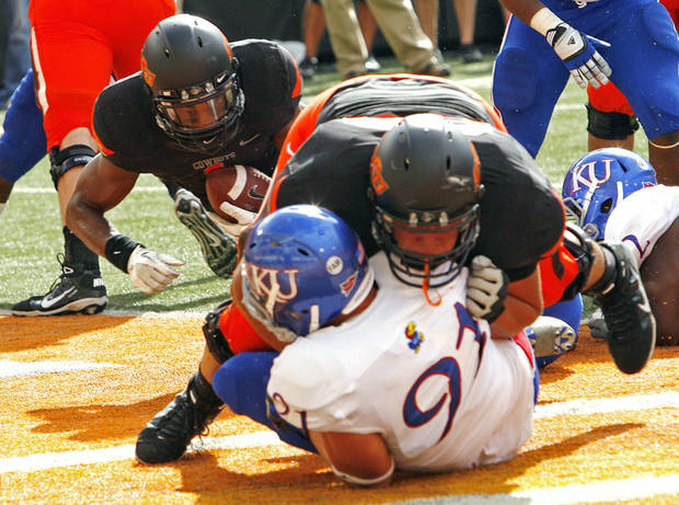 Oklahoma State's Joseph Randle (1) scores behind a block by Lane Taylor (68) during a college football game between the Oklahoma State University Cowboys (OSU) and the University of Kansas Jayhawks (KU) at Boone Pickens Stadium in Stillwater, Okla., Saturday, Oct. 8, 2011 Photo by Steve Sisney, The Oklahoman