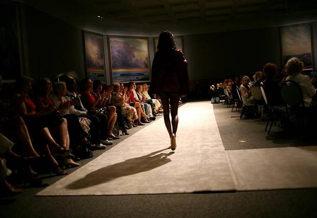 A model walks down the runway during a fashion show called Insight, a celebration of Culture and Style at National Cowboy and Western Heritage Museum in Oklahoma City on Tuesday, July 19, 2011. The show featured modern styles inspired by traditional Afghan and Rwandan attire. Students from Oklahoma State University designed and created some of the clothing featured in the show. All proceeds from the event benefit The Institute for Economic Empowerment of Women and their program called Peace Through Business. Photo by John Clanton, The Oklahoman
