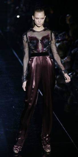 A model wears a creation for Gucci women&#039;s Fall-Winter 2013-14 collection, part of the Milan Fashion Week, unveiled in Milan, Italy, Wednesday, Feb. 20, 2013. (AP Photo/Luca Bruno)