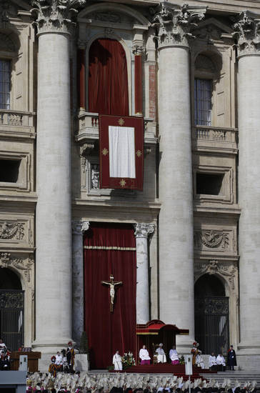 Pope Francis sits at the steps of St. Peter's Basilica during his inaugural Mass in St. Peter's Square at the Vatican, Tuesday, March 19, 2013. (AP Photo/Gregorio Borgia)