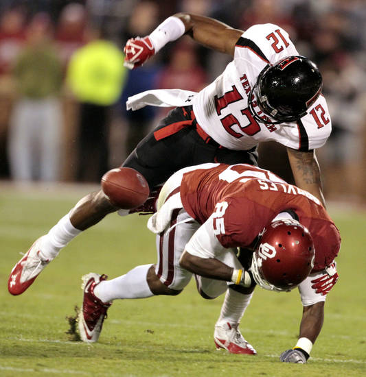 Texas Tech's D.J. Johnson (12) strips the ball from Oklahoma's Ryan Broyles (85) after a long pass play during the first half of the college football game between the University of Oklahoma Sooners (OU) and Texas Tech University Red Raiders (TTU) at the Gaylord Family-Memorial Stadium on Saturday, Oct. 22, 2011. in Norman, Okla. Photo by Steve Sisney, The Oklahoman