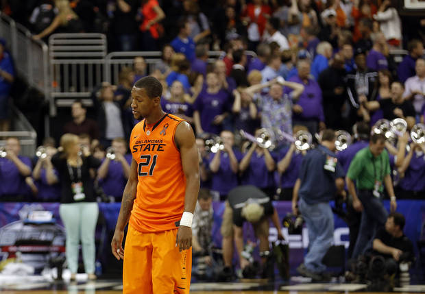 Oklahoma State's Kamari Murphy (21) reacts to the Cowboys' loss following the Phillips 66 Big 12 Men's basketball championship tournament game between Oklahoma State University and Kansas State at the Sprint Center in Kansas City, Friday, March 15, 2013. Photo by Sarah Phipps, The Oklahoman