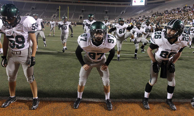 Norman North goes through pre-game warm ups during the Class 6A Oklahoma state championship football game between Norman North High School and Jenks High School at Boone Pickens Stadium on Friday, Nov. 30, 2012, in Stillwater, Okla.   Photo by Chris Landsberger, The Oklahoman