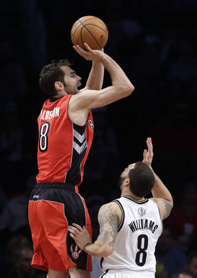 Toronto Raptors guard Jose Calderon shoots over Brooklyn Nets guard Deron Williams during the first half of an NBA basketball game Tuesday, Jan. 15, 2013, in New York. (AP Photo/Kathy Willens)