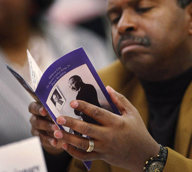 "A man flips through the souvenir program while attending the 16th annual Midwest City Dr. Martin Luther King, Jr. Prayer Breakfast inside the Reed Conference Center Monday morning, Jan. 21, 2013. The theme of this year's event is ""The Wisdom of Peace."" About 400 people attended.   Photo by Jim Beckel, The Oklahoman"