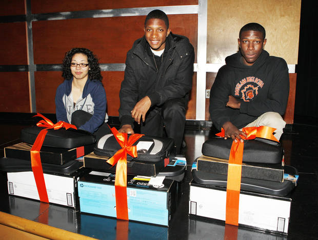 Douglass High School students Katherine Rodas, sophomore, Anthonio Humphrey, junior and Shariff Tucker, senior, with laptops they won for the �Celebrate Black History Month Essay Contest.� Photo by Paul B. Southerland, The Oklahoman