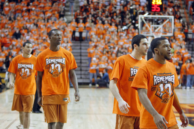 "Texas players warm up wearing ""Remember the 10""  T-shirts before the basketball game between Oklahoma State and Texas, Wednesday, Jan. 26, 2011, Stillwater, Okla. Photo by Sarah Phipps, The Oklahoman"