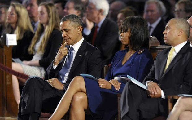 President Barack Obama, first lady Michelle Obama and Massachusetts Gov. Deval Patick attend an interfaith healing service at the Cathedral of the Holy Cross in Boston, Thursday, April 18, 2013, for victims of Monday's Boston Marathon explosions. (AP Photo/Susan Walsh)