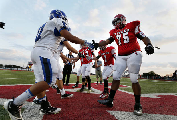 Team captains meet for the coin toss before a high school football game between the Carl Albert Titans and the Deer Creek Antlers on Friday, Sept. 27, 2013 in Midwest City, Okla. Photo by Steve Sisney, The Oklahoman