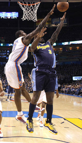 Oklahoma City's Serge Ibaka (9) blocks Denver's Ty Lawson's (3) shot during the NBA basketball game between the Denver Nuggets and the Oklahoma City Thunder in the first round of the NBA playoffs at the Oklahoma City Arena, Wednesday, April 27, 2011. Photo by Sarah Phipps, The Oklahoman