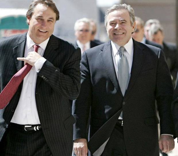 Mike Morgan (right) and Attorney David Ogle (left) walk toward the Federal Courthouse in Oklahoma City on Wednesday, April 6, 2011. Former Senate leader Mike Morgan, lobbyist Andrew Skeith and attorney Martin Stringer pleaded not guilty at a 13-minute arraignment today in a public corruption case. Photo by John Clanton, The Oklahoman ORG XMIT: KOD