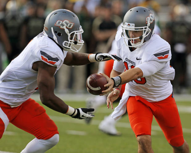 Oklahoma State's Clint Chelf (10) hands the ball to Joseph Randle (1) during a college football game between the Oklahoma State University Cowboys (OSU) and the Baylor University Bears at Floyd Casey Stadium in Waco, Texas, Saturday, Dec. 1, 2012. Photo by Nate Billings, The Oklahoman