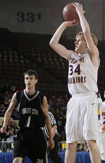 Okarche's Bryce Carver (34) shoots in front of Wright City's Colton Converse (1) during a quarterfinal game between Wright City and Okarche in the Class A boys high school basketball state tournament at State Fair Arena in Oklahoma City, Thursday, March 1, 2012. Okarche won, 59-47. Photo by Nate Billings, The Oklahoman