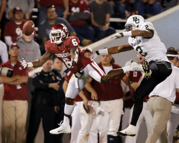 Oklahoma Sooners&#039;s Demontre Hurst (6) tries to intercept a pass intended for Baylor Bear&#039;s Terrance Williams (2) during the the second half of the college football game where  the University of Oklahoma Sooners (OU) defeated the Baylor University Bears (BU) 42-34 at Gaylord Family-Oklahoma Memorial Stadium in Norman, Okla., Saturday, Nov. 10, 2012.  Photo by Steve Sisney, The Oklahoman