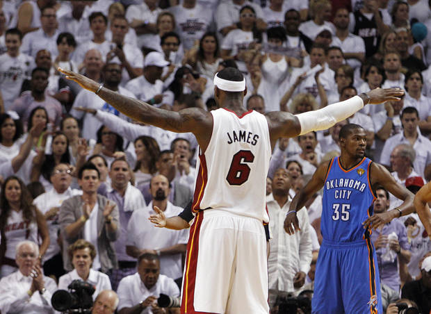 Miami Heat small forward LeBron James (6) and Oklahoma City Thunder small forward Kevin Durant (35) react during the second half at Game 3 of the NBA Finals basketball series, Sunday, June 17, 2012, in Miami. (AP Photo/Lynne Sladky) ORG XMIT: NBA153