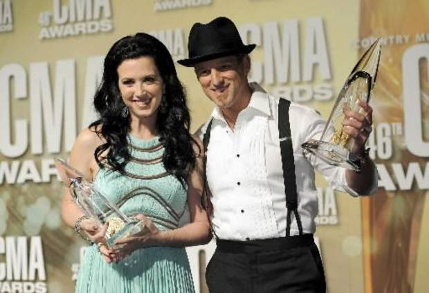 Shawna and Keifer Thompson show off their trophies backstage at the CMA Awards.