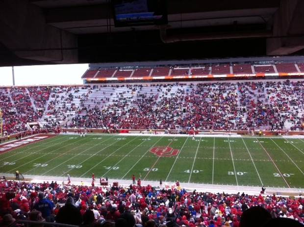 The sparse crowd at the OU-Iowa State game in late November