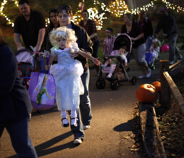 Kelly Parker carries her daughter, Samantha Parker, 3, of Oklahoma CIty up a hill during Haunt The Zoo in Oklahoma City, Tuesday, October 26, 2010.  Photo by Bryan Terry, The Oklahoman