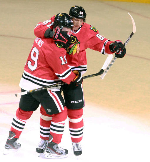 Chicago Blackhawks center Jonathan Toews celebrates a goal by Chicago Blackhawks right wing Marian Hossa in the first period  as the Blackhawks defeated the Minnesota Wild 5-1 in Game 5 of an NHL hockey Stanley Cup first-round playoff series in Chicago, Thursday, May 9, 2013. (AP Photo/Daily Herald,  George LeClaire)