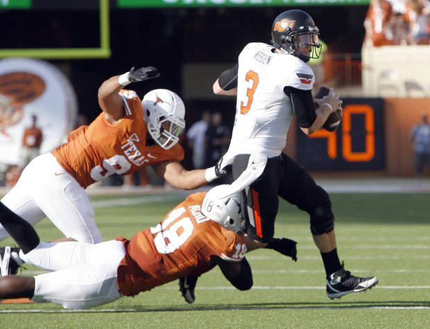 Texas&#039; Dravannti Johnson (9) and Emmanuel Acho (18) pressure Oklahoma State&#039;s Brandon Weeden (3)during second half of a college football game between the Oklahoma State University Cowboys (OSU) and the University of Texas Longhorns (UT) at Darrell K Royal-Texas Memorial Stadium in Austin, Texas, Saturday, Oct. 15, 2011. Photo by Sarah Phipps, The Oklahoman  