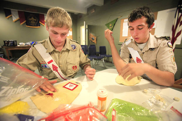 Jonah Moore and Matt Harger work to replace Boy Scout regalia lost in a recent wildfire.Photo by David McDaniel, The Oklahoman