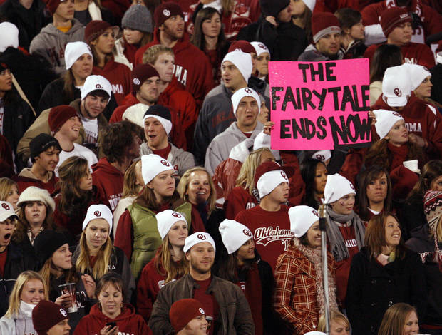 A fan in the OU student section holds a sign that reads &quot;The Fairytale Ends Now&quot; before the college football game between the University of Oklahoma Sooners and Texas Tech University at Gaylord Family -- Oklahoma Memorial Stadium in Norman, Okla., Saturday, Nov. 22, 2008. BY NATE BILLINGS, THE OKLAHOMAN