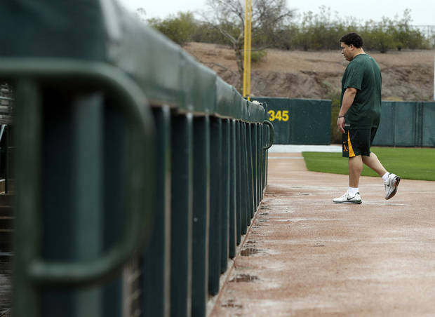 Oakland Athletics' Bartolo Colon arrives for the start of baseball spring training Monday, Feb. 11, 2013, in Phoenix. (AP Photo/Darron Cummings)