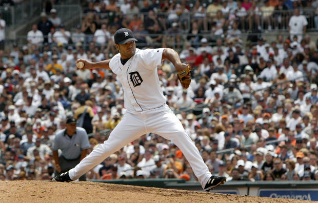 Detroit Tigers closer Ugueth Urbina throws against the New York Yankees in the ninth inning in Detroit, Sunday, July 18, 2004. The Detroit Tigers surpassed their 2003 wins total with 2 1/2 months left in the season, beating the New York Yankees 4-2 before a sellout crowd of 40,132. (AP Photo/Paul Sancya)