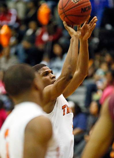 Douglass' Stephen Clark (5) shoots a free throw to score the 3,000th point of his career during a boys high school basketball game between Douglass and Northeast at Douglass High School in Oklahoma City, Friday, Feb. 8, 2013. Photo by Nate Billings, The Oklahoman