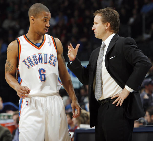 Oklahoma City head coach Scott Brooks talks to Eric Maynor (6) during the NBA basketball game between the Oklahoma City Thunder and the New York Knicks at the Ford Center in Oklahoma City, January 11, 2010. Photo by Nate Billings, The Oklahoman