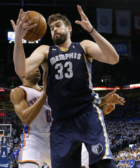 Memphis' Marc Gasol (33) goes past Oklahoma City's Derek Fisher (6) during Game 2 in the second round of the NBA playoffs between the Oklahoma City Thunder and the Memphis Grizzlies at Chesapeake Energy Arena in Oklahoma City, Tuesday, May 7, 2013. Oklahoma  City lost 99-93. Photo by Bryan Terry, The Oklahoman