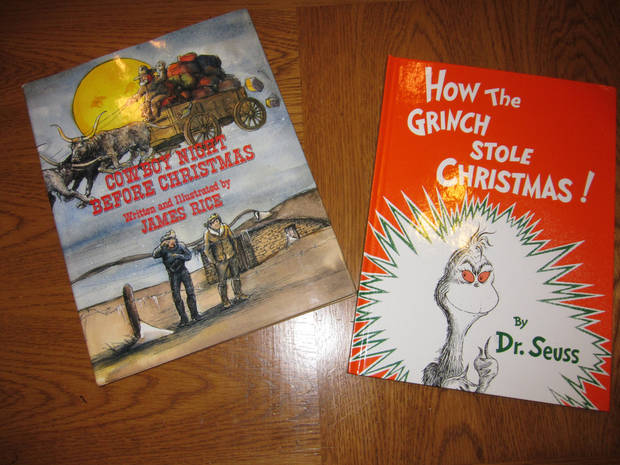 Two of the Christmas books Jan Larsen has given to her children and their families are pictured here. Photo by Carla Hinton <strong></strong>