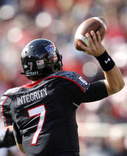 Texas Tech Red Raiders's Seth Doege (7) looks to pass during a college football game between Texas Tech University (TTU) and Oklahoma State University (OSU) at Jones AT&T Stadium in Lubbock, Texas, Saturday, Nov. 12, 2011.  Photo by Sarah Phipps, The Oklahoman  ORG XMIT: KOD