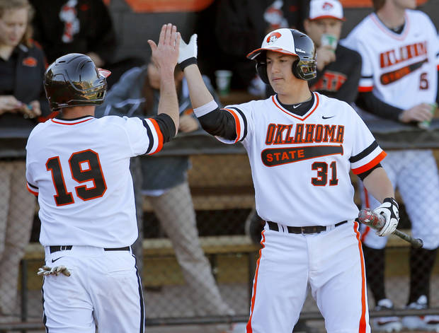 OKLAHOMA STATE UNIVERSITY / OSU / CELEBRATION: Oklahoma State's Aaron Cornell, left, celebrates with Victor Romero after scoring in the first inning of OSU's college baseball game against Alcorn State in Stillwater, Okla., Tuesday, Feb. 19, 2013. Photo by Bryan Terry, The Oklahoman
