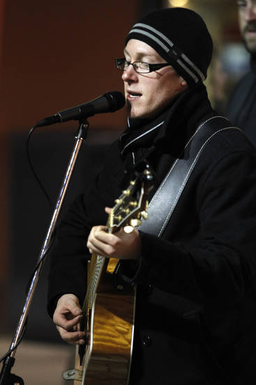 Jamie Bramble, of Oklahoma City, plays live music during Black Friday at The Outlet Shoppes at Oklahoma City, Friday, Nov. 25, 2011.  Photo by Garett Fisbeck, For The Oklahoman