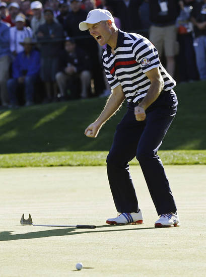 USA's Jim Furyk reacts after missing a putt on the 16th hole during a singles match at the Ryder Cup PGA golf tournament Sunday, Sept. 30, 2012, at the Medinah Country Club in Medinah, Ill. (AP Photo/David J. Phillip)  ORG XMIT: PGA175