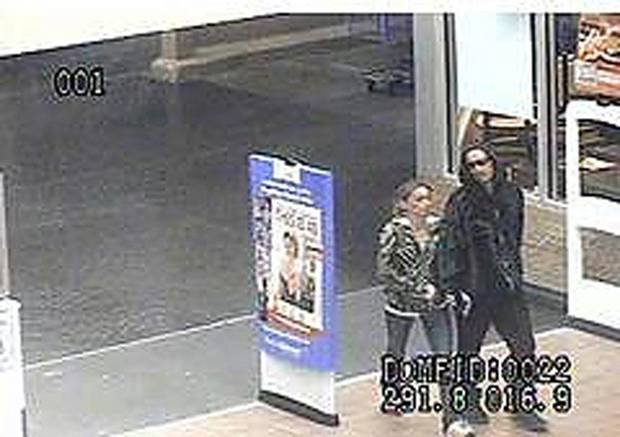 Investigators have released a photo from surveillance video taken at the Walmart at Interstate 240 and Shields Boulevard. It shows two people who used a credit card stolen March 30 from a car in Harrah. <strong>PROVIDED</strong>