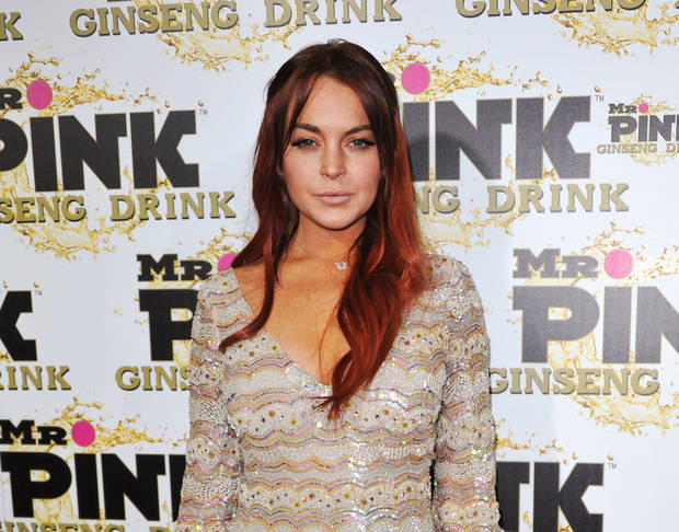 FILE - In this Oct. 11, 2012 file photo, Lindsay Lohan attends the Mr. Pink Ginseng launch party at the Beverly Wilshire hotel in Beverly Hills, Calif.  Lohan&#039;s attorney wrote in a letter filed in court on Feb. 22, 2013, that the  actress is willing to record public service announcements and provide inspirational talks at schools and hospitals as a possible way to resolve a case that alleges she lied to police about a car accident. (Photo by Richard Shotwell/Invision/AP, File)