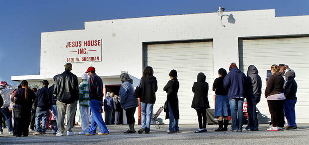 People line up outside the Jesus House's warehouse to receive free Thanksgiving turkeys and groceries on  Nov. 19, 2012. <strong>Jim Beckel - THE OKLAHOMAN</strong>