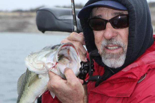 Just because it's cold doesn't mean you can't catch bass. Former Bassmaster Classic champion Ken Cook of Meers recommends fishing more slowly and using lighter tackle for winter bites. PHOTO PROVIDED