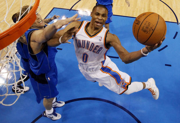 Oklahoma City's Russell Westbrook (0) takes the ball to the hoop past Dallas' Delonte West (13) and Dirk Nowitzki (41)  during Game 2 of the first round in the NBA basketball  playoffs between the Oklahoma City Thunder and the Dallas Mavericks at Chesapeake Energy Arena in Oklahoma City, Monday, April 30, 2012. Photo by Nate Billings, The Oklahoman