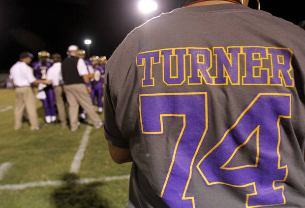 A fan watches the game from the sidelines during the football game between Chickasha and Capitol Hill at Chickasha High School, Friday, Oct. 1, 2010. It was the first home game since the death of player Kody Turner. Photo by Sarah Phipps, The Oklahoman