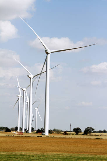 Wind turbines are shown at the Canadian Hills Wind Farm. Google Inc. has signed a deal to purchase wind power. . Photo By Steve Gooch,  The Oklahoman