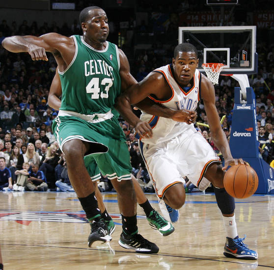 Kevin Durant (35) of Oklahoma City tries to drive past Kendrick Perkins (43) of Boston in the second half of the NBA basketball game between the Boston Celtics and the Oklahoma City Thunder at the Ford Center in Oklahoma City, Friday, Dec. 4, 2009. Boston won, 105-87. Photo by Nate Billings, The Oklahoman