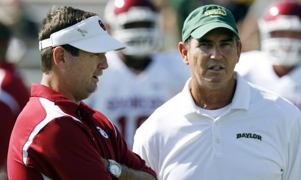 Baylor coach Art Briles chats with OU coach Bob Stoops before a game. (Photo by Steve Sisney)