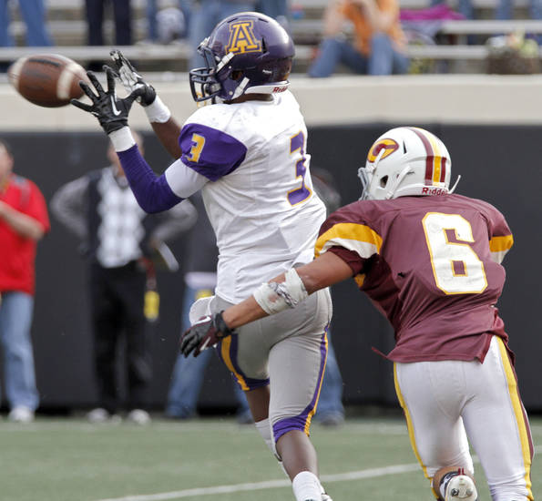 Anadarko's Josh Parton (3) makes a reception in front of Clinton's Devon Mitchell (6) during the Class 4A Oklahoma state championship football game between Anadarko and Clinton at Boone Pickens Stadium on Saturday, Dec. 1, 2012, in Stillwater, Okla.   Photo by Chris Landsberger, The Oklahoman