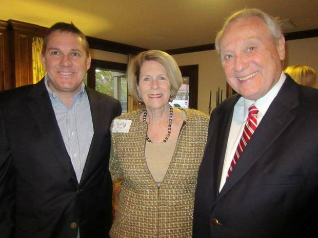 Host Cliff Branan, Kathy Walker and Stewart Meyers were at the party. (Photo by Helen Ford Wallace).